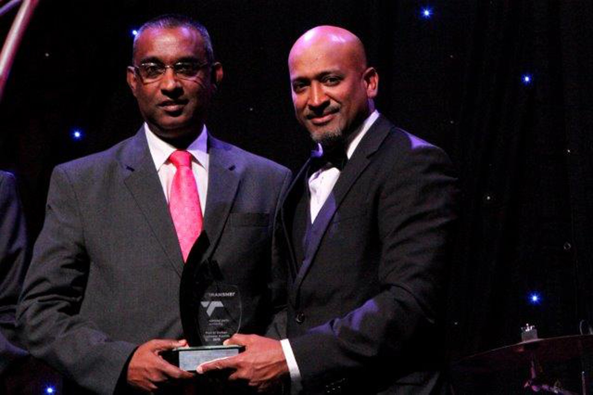 Ivan Pillay accepting the award from Richard Vallihu